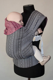 Reversible Karaush ergo baby carrier made of sling fabric of different colors and types of weaving